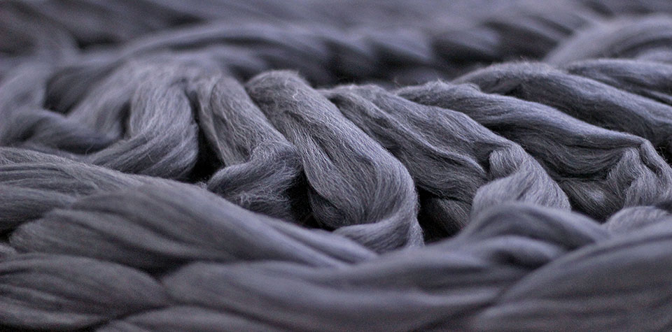 Grey wool yarn to be made into Pierre Robert Wool Collection garments.
